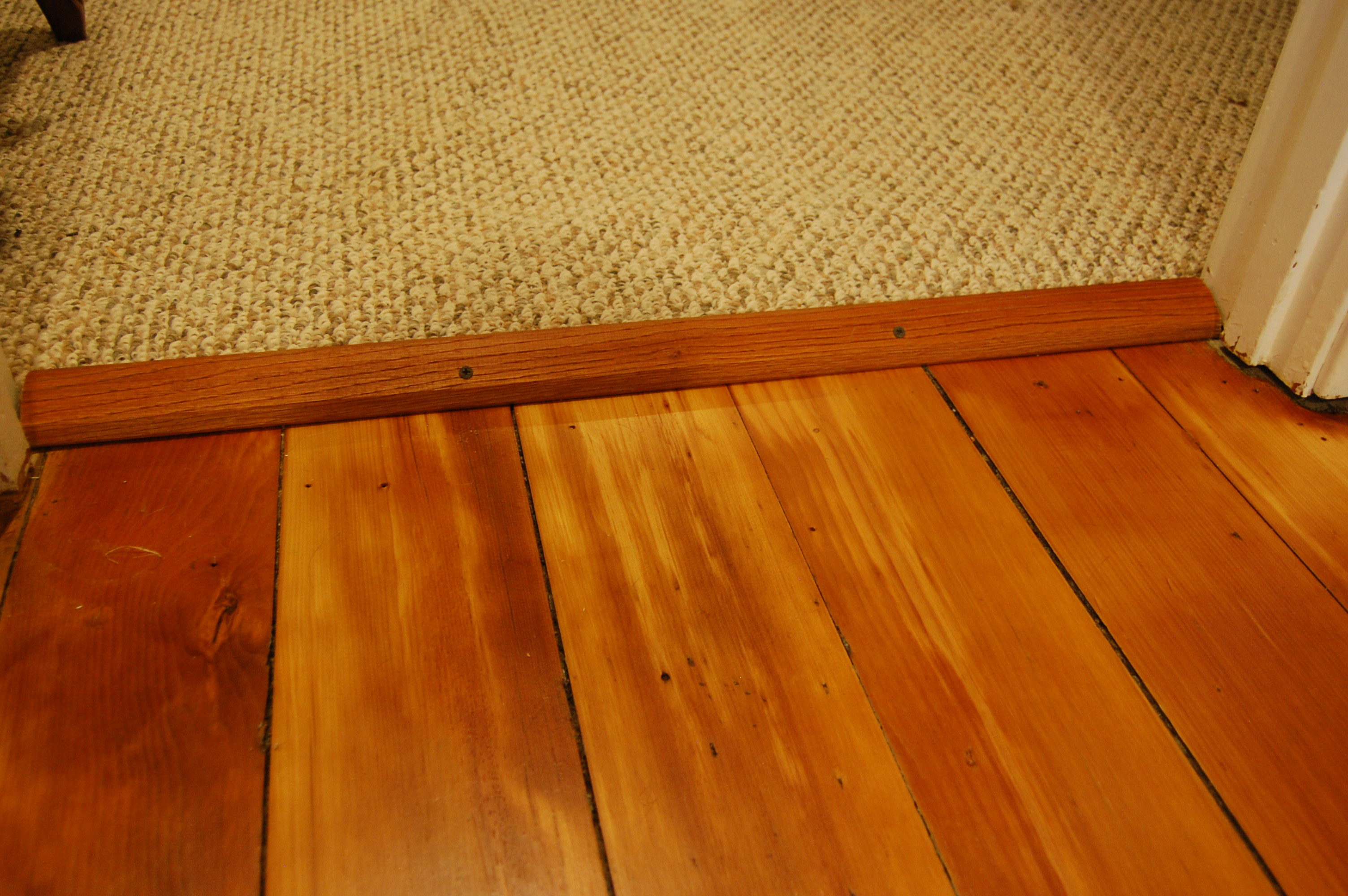 Wood floor carpet srs transition carpet vidalondon for Hardwood floors uneven